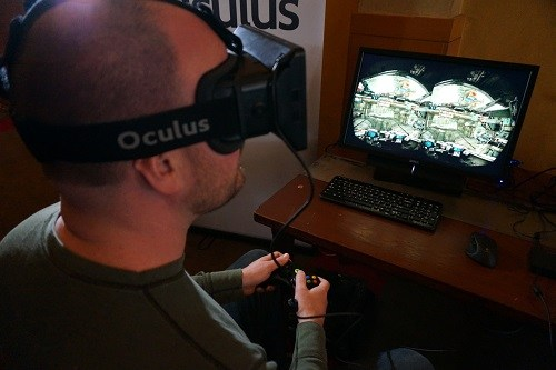 Man Playing Game Using Oculus Rift VR Headset