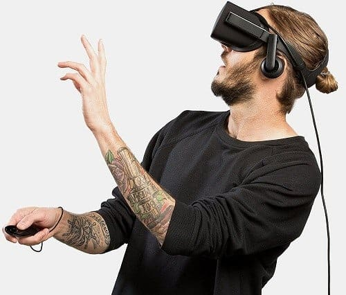 Man With Tatoos Using Oculus Rift Headset