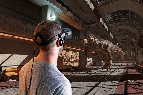 Man Using Oculus and Looking at a Dinosaur