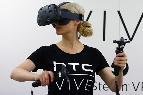 Woman Wearing HTC Vive and Using Joyticks
